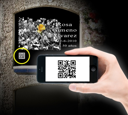 With your phone or tablet focus towards the QR code of the headstone ...